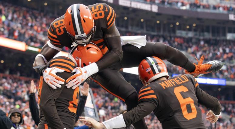 Dec 23, 2018; Cleveland, OH, USA; Cleveland Browns tight end Darren Fells (88) gets congratulated by quarterback Baker Mayfield (6) as tight end David Njoku (85) jumps on top of them during the second quarter against the Cincinnati Bengals at FirstEnergy