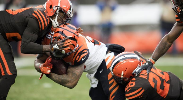 Dec 23, 2018; Cleveland, OH, USA; Cleveland Browns strong safety Damarious Randall (23) and cornerback Derrick Kindred (26) tackle Cincinnati Bengals running back Joe Mixon (28) during the second half at FirstEnergy Stadium. Mandatory Credit: Ken Blaze-US