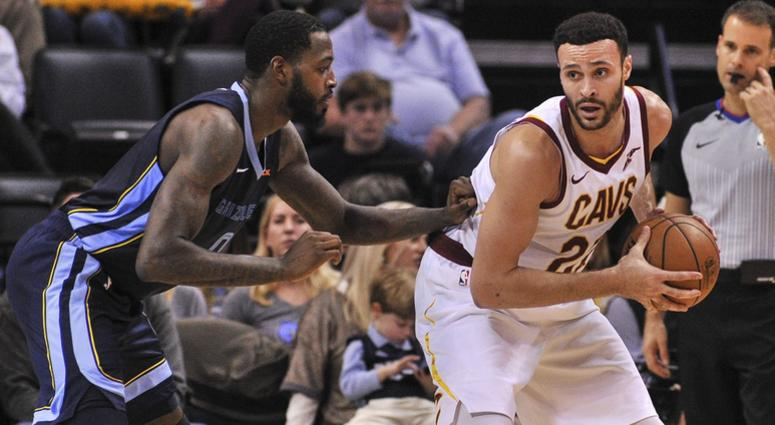 Dec 26, 2018; Memphis, TN, USA; Cleveland Cavaliers forward Larry Nance Jr. (22) handles the ball against Memphis Grizzlies forward JaMychal Green (0) during the first half at FedExForum. Mandatory Credit: Justin Ford-USA TODAY Sports