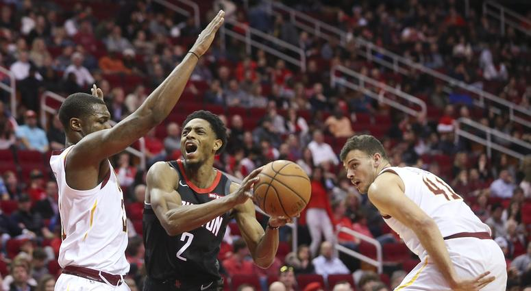 Jan 11, 2019; Houston, TX, USA; Houston Rockets guard Brandon Knight (2) spilts the defense of Cleveland Cavaliers guard Collin Sexton (2) and center Ante Zizic (41) in the second half at Toyota Center. Mandatory Credit: Thomas B. Shea-USA TODAY Sports