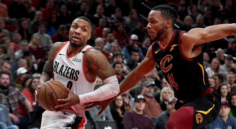 Jan 16, 2019; Portland, OR, USA; Portland Trail Blazers guard Damian Lillard (0) dribbles the ball past Cleveland Cavaliers forward Jaron Blossomgame (4) during the first half at the Moda Center. Mandatory Credit: Steve Dykes-USA TODAY Sports