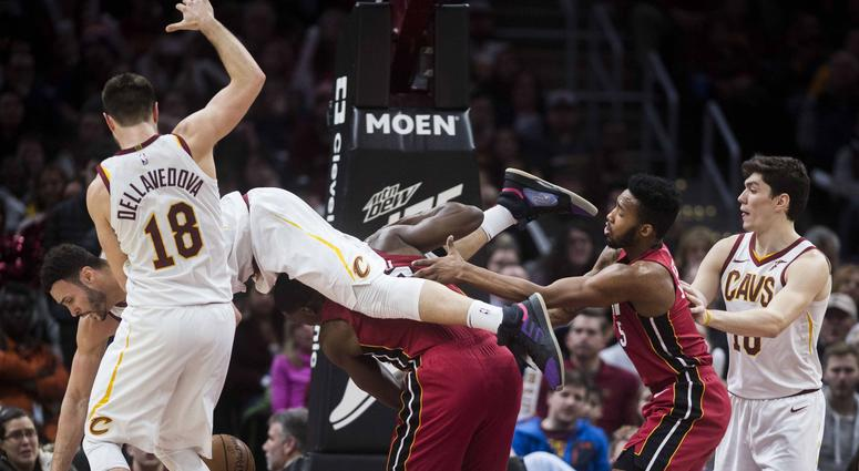 Cleveland Cavaliers forward Larry Nance Jr. (22) comes down on top of Miami Heat center Bam Adebayo (13) during the second half at Quicken Loans Arena.