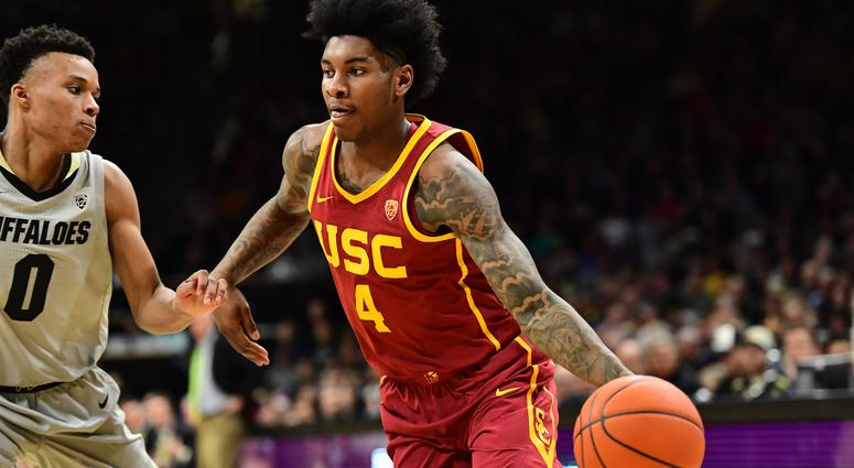 Mar 9, 2019; Boulder, CO, USA; USC Trojans guard Kevin Porter Jr. (4) drives on Colorado Buffaloes guard Shane Gatling (0) in the second half at the CU Events Center Mandatory Credit: Ron Chenoy-USA TODAY Sports