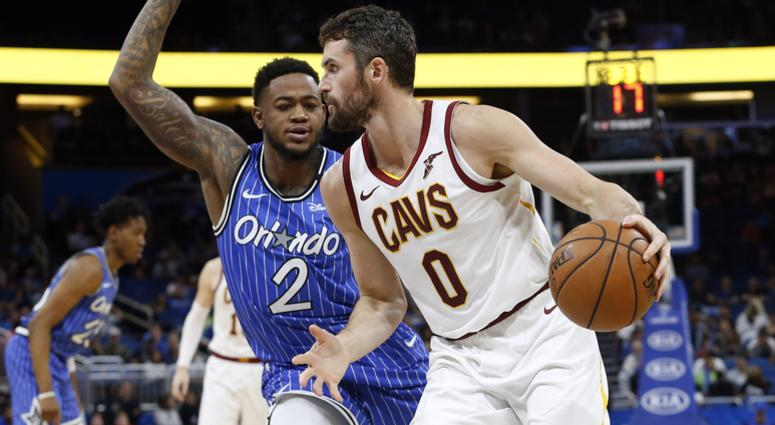 Mar 14, 2019; Orlando, FL, USA; Cleveland Cavaliers forward Kevin Love (0) drives to the basket as Orlando Magic forward Jarell Martin (2) defends during the second half at Amway Center. Mandatory Credit: Kim Klement-USA TODAY Sports
