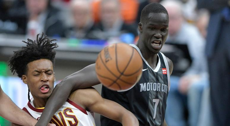 Mar 18, 2019; Cleveland, OH, USA; Cleveland Cavaliers guard Collin Sexton (2) and Detroit Pistons forward Thon Maker (7) go for a loose ball in the first quarter at Quicken Loans Arena. Mandatory Credit: David Richard-USA TODAY Sports