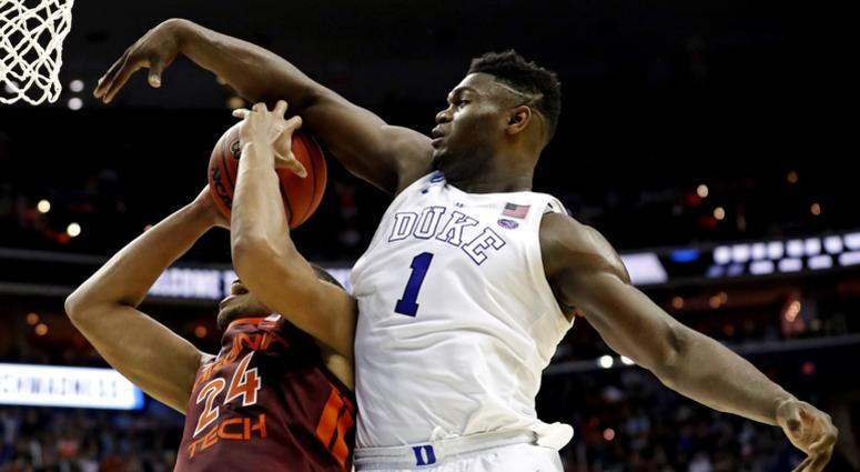 Virginia Tech Hokies forward Kerry Blackshear Jr. (24) is fouled by Duke Blue Devils forward Zion Williamson (1) during the second half in the semifinals of the east regional of the 2019 NCAA Tournament at Capital One Arena.