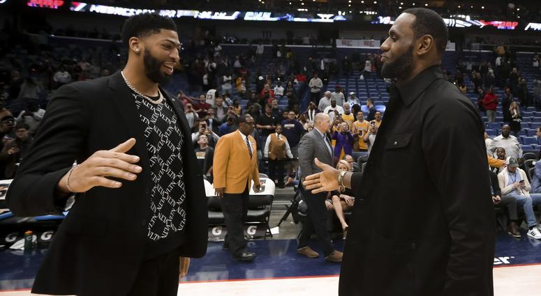 New Orleans Pelicans forward Anthony Davis meets with Los Angeles Lakers forward LeBron James following a game at the Smoothie King Center.