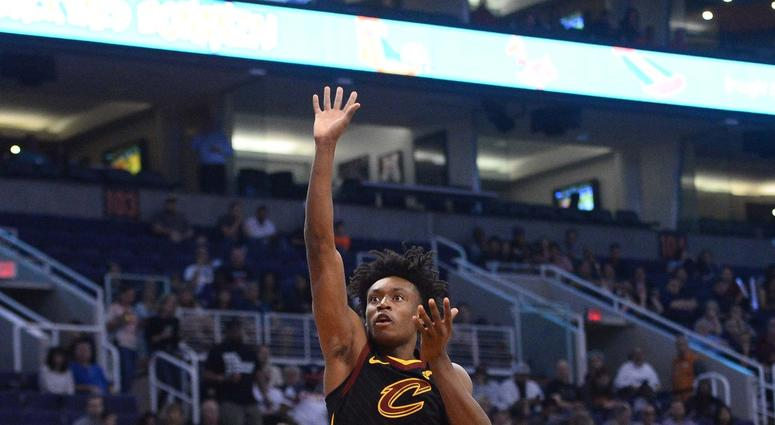 Cleveland Cavaliers guard Collin Sexton (2) shoots over Phoenix Suns forward Richaun Holmes (21) during the first half at Talking Stick Resort Arena.