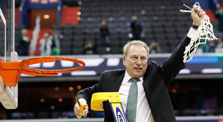 Michigan State Spartans head coach Tom Izzo cuts down the net after the Spartans' game against the Duke Blue Devils in the championship game of the east regional of the 2019 NCAA Tournament at Capital One Arena.