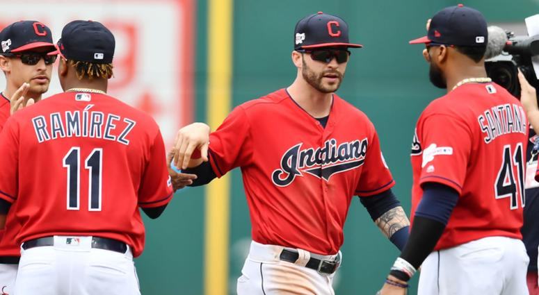 Apr 7, 2019; Cleveland, OH, USA; Cleveland Indians third baseman Jose Ramirez (11) and right fielder Tyler Naquin (center) and first baseman Carlos Santana (41) celebrate after the Indians defeated the Toronto Blue Jays at Progressive Field.