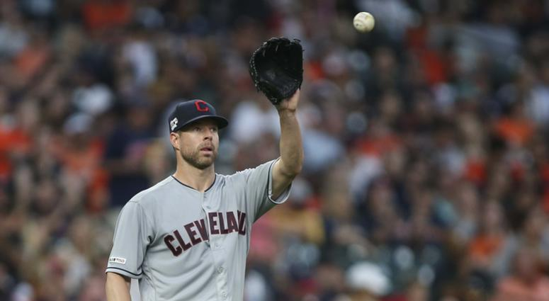 Cleveland Indians starting pitcher Corey Kluber (28) reacts after a play during the second inning against the Houston Astros at Minute Maid Park.