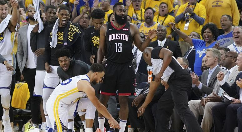 Golden State Warriors guard Stephen Curry (30) and NBA referee Courtney Kirkland (61) point after Houston Rockets guard James Harden (13) stepped out of bounds during the fourth quarter in game one of the second round of the 2019 NBA Playoffs at Oracle Ar