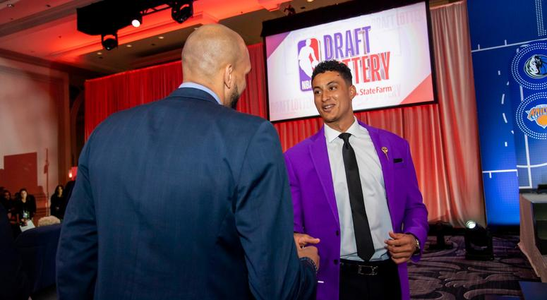May 14, 2019; Chicago, IL, USA; Los Angeles Lakers player Kyle Kuzma (right) is seen during the 2019 NBA Draft Lottery at the Hilton Chicago. Mandatory Credit: Patrick Gorski-USA TODAY Sports