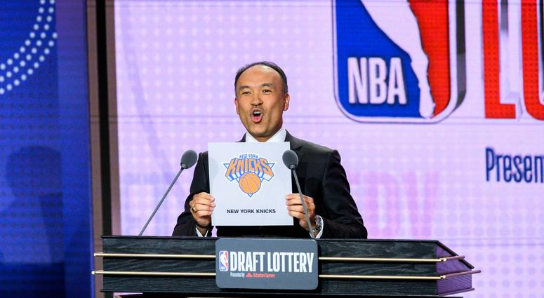 May 14, 2019; Chicago, IL, USA; NBA deputy commissioner Mark Tatum reveals the number three pick for the New York Knicks during the 2019 NBA Draft Lottery at the Hilton Chicago. Mandatory Credit: Patrick Gorski-USA TODAY Sports