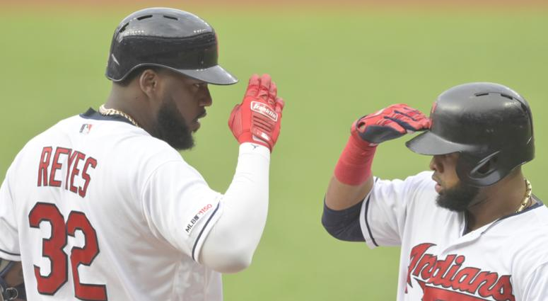 Aug 12, 2019; Cleveland, OH, USA; Cleveland Indians designated hitter Franmil Reyes (32) celebrates his two-run home run with first baseman Carlos Santana (41) in the first inning against the Boston Red Sox at Progressive Field. Mandatory Credit: David Ri