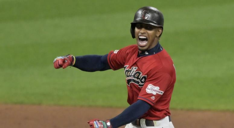 Aug 13, 2019; Cleveland, OH, USA; Cleveland Indians shortstop Francisco Lindor (12) reacts after hitting an RBI double in the ninth inning against the Boston Red Sox at Progressive Field. Mandatory Credit: David Richard-USA TODAY Sports