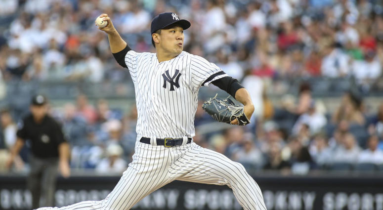 Aug 16, 2019; Bronx, NY, USA; New York Yankees pitcher Masahiro Tanaka (19) pitches in the first inning against the Cleveland Indians at Yankee Stadium. Mandatory Credit: Wendell Cruz-USA TODAY Sports