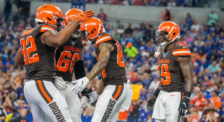 Cleveland Browns wide receiver Derrick Willies (84) celebrates his touchdown with teammates in the second half of the game against the Indianapolis Colts at Lucas Oil Stadium.