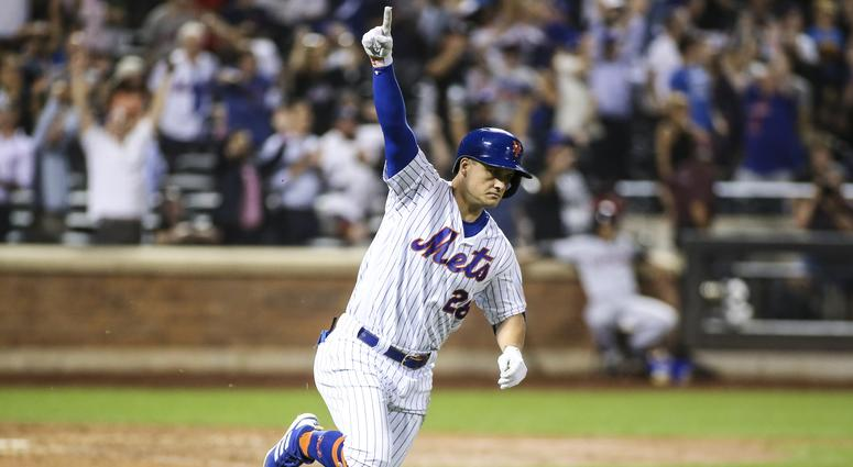 New York Mets left fielder J.D. Davis (28) hits a game winning RBI single defeat the Cleveland Indians in the tenth inning to at Citi Field.