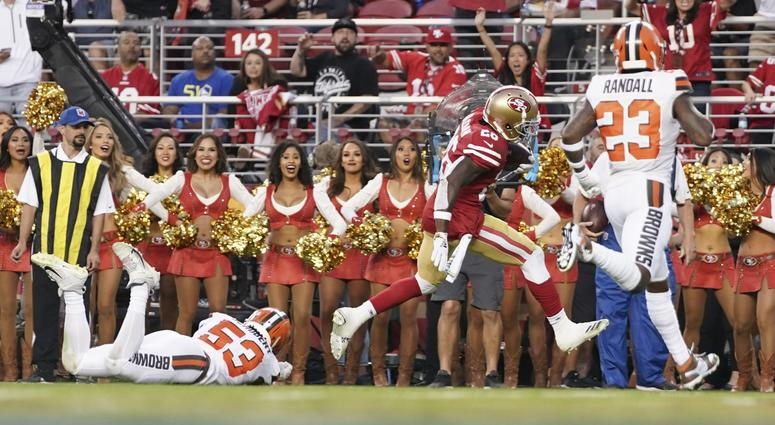 San Francisco 49ers running back Tevin Coleman (26) scores a touchdown against Cleveland Browns middle linebacker Joe Schobert (53) and strong safety Damarious Randall (23) during the second quarter at Levi s Stadium.
