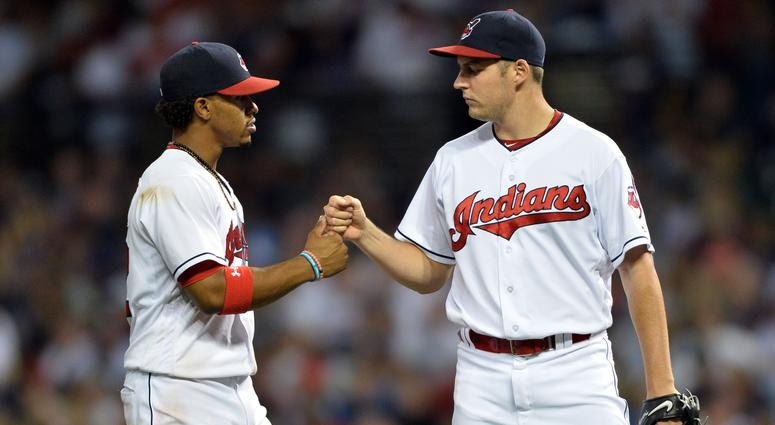 Sep 3, 2016; Cleveland, OH, USA; Cleveland Indians shortstop Francisco Lindor (12) and Cleveland Indians starting pitcher Trevor Bauer (47) celebrate during the ninth inning against the Miami Marlins at Progressive Field. Mandatory Credit: Ken Blaze-USA T