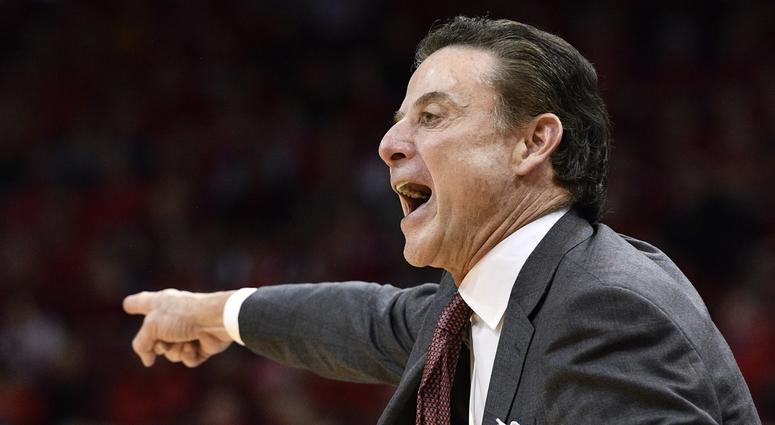 Louisville Cardinals head coach Rick Pitino calls out instructions during the second half against the Notre Dame Fighting Irish at KFC Yum! Center. Louisville defeated Notre Dame 71-64.
