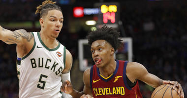 Cleveland Cavaliers' Collin Sexton (2) drives past Milwaukee Bucks' D.J. Wilson (5) during the second half of an NBA basketball game Wednesday, March 20, 2019, in Cleveland. The Cavaliers won 107-102. (AP Photo/Tony Dejak)
