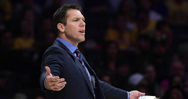 Los Angeles Lakers coach Luke Walton gestures during the second half of the team's NBA basketball game against the Portland Trail Blazers on Tuesday, April 9, 2019, in Los Angeles. The Trail Blazers won 104-101. (AP Photo/Mark J. Terrill)