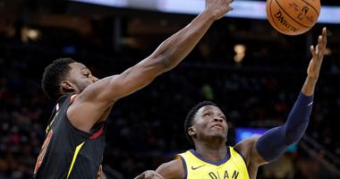 Cavaliers' Jeff Green, left, and Indiana Pacers' Victor Oladipo (4) battle for a rebound in the first half of Game 1 of an NBA basketball first-round playoff series