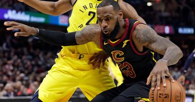 Cavaliers' LeBron James, right, drives against Indiana Pacers' Thaddeus Young during the first half of Game 2 of an NBA basketball first-round playoff series