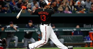 Baltimore Orioles' Manny Machado watches his solo home run in the fourth inning of a baseball game against the Cleveland Indians, Friday, April 20, 2018, in Baltimore.