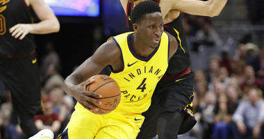 Indiana Pacers' Victor Oladipo (4) drive past Cleveland Cavaliers' Jose Calderon (81), from Spain, in the second half of Game 5 of an NBA basketball first-round playoff series, Wednesday, April 25, 2018, in Cleveland. The Cavaliers won 98-95. (AP Photo/To