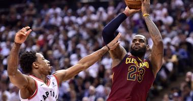 Cleveland Cavaliers forward LeBron James (23) shoots over Toronto Raptors forward Pascal Siakam during the second half of Game 2 of an NBA basketball playoffs second-round series Thursday, May 3, 2018, in Toronto. (Frank Gunn/The Canadian Press via AP)