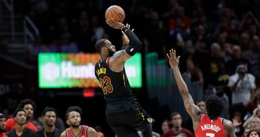 Cleveland Cavaliers' LeBron James (23) hits the game-winning shot as Toronto Raptors' OG Anunoby (3) and CJ Miles (0) watch during the second half of Game 3 of an NBA basketball second-round playoff series, Saturday, May 5, 2018, in Cleveland.