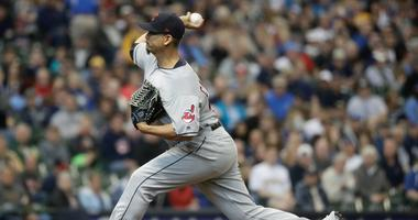 Cleveland Indians starting pitcher Carlos Carrasco throws during the first inning of a baseball game against the Milwaukee Brewers Wednesday, May 9, 2018, in Milwaukee.