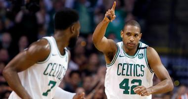 Celtics forward Al Horford (42) celebrates a made basket with guard Jaylen Brown (7) during the first quarter of Game 1 of the NBA basketball Eastern Conference Finals against the Cleveland Cavaliers