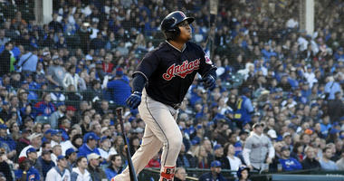 Cleveland Indians' Jose Ramirez (11) hits a three-run home run against the Chicago Cubs during the third inning of an interleague baseball game, Tuesday, May 22, 2018, in Chicago.
