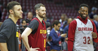 Cleveland Cavaliers forward Larry Nance Jr., center Kevin Love and forward Jeff Green cool down after practice Tuesday, June 5, 2018, at Quicken Loans Arena in Cleveland, Ohio.