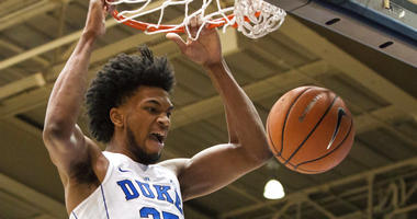FILE - In this Jan. 27, 2018, file photo, Duke's Marvin Bagley III (35) dunks the ball during the first half of an NCAA college basketball game against Virginia in Durham, N.C. Marvin Bagley III dominated at Duke, while fellow freshman Michael Porter Jr.