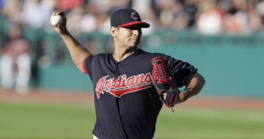 Cleveland Indians starting pitcher Carlos Carrasco delivers in the first inning of a baseball game against the Oakland Athletics, Friday, July 6, 2018, in Cleveland.