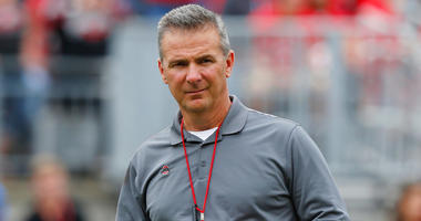 Ohio State coach Urban Meyer watches the NCAA college football team's spring game in Columbus, Ohio. Ohio State has placed Meyer on paid administrative leave.