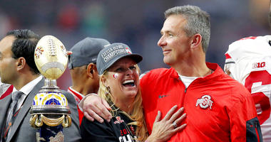 Ohio State head coach Urban Meyer hugs his wife, Shelley, after their 44-28 win over Notre Dame in the Fiesta Bowl NCAA college football game, in Glendale, Ariz. Ohio State placed Meyer on paid administrative leave Wednesday, Aug. 1, 2018, while it invest