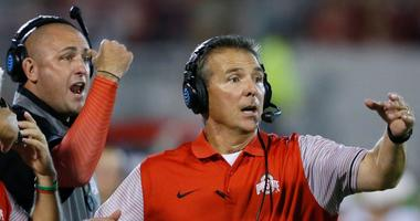 FILE - In this Sept. 17, 2016, file photo, Ohio State head coach Urban Meyer, right, and then-assistant coach Zach Smith, left, gesture from the sidelines during an NCAA college football game against Oklahoma in Norman, Okla.