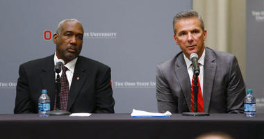 Ohio State football coach Urban Meyer, right, answers questions as athletic director Gene Smith listens during a news conference in Columbus, Ohio, Wednesday, Aug. 22, 2018.