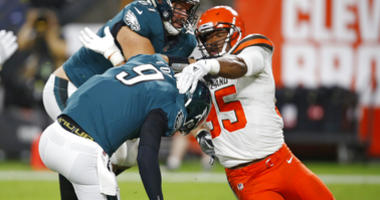 Cleveland Browns defensive end Myles Garrett (95) takes down Philadelphia Eagles quarterback Nick Foles (9) for a safety during the first half of an NFL preseason football game Thursday, Aug. 23, 2018, in Cleveland. (AP Photo/Ron Schwane)