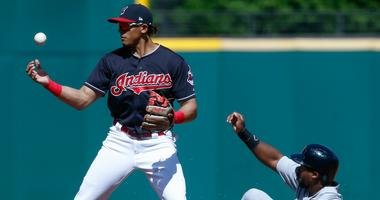 Cleveland Indians' Erik Gonzalez, left, forces out Detroit Tigers' Christin Stewart at second base but then misplays the throw on a ball hit by Nicholas Castellanos during the first inning of a baseball game, Sunday, Sept. 16, 2018, in Cleveland.