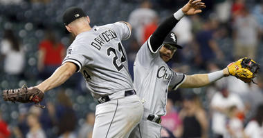 Chicago White Sox's Matt Davidson (24) and Yolmer Sanchez celebrate the team's 5-4 win against the Cleveland Indians in a baseball game Thursday, Sept. 20, 2018, in Cleveland.
