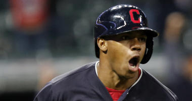 Cleveland Indians' Greg Allen celebrates as he runs to first on his game winning single in the eleventh inning of a baseball game against the Boston Red Sox, Sunday, Sept. 23, 2018, in Cleveland. Cleveland won 4-3.