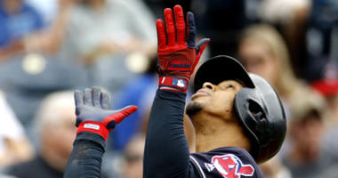 Cleveland Indians' Francisco Lindor celebrates as he crosses the plate after hitting a solo home run during the third inning of a baseball game against the Kansas City Royals Sunday, Sept. 30, 2018, in Kansas City, Mo.