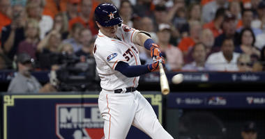 Houston Astros' Alex Bregman hits a solo home run against the Cleveland Indians' Corey Kluber during the fourth inning in Game 1 of an American League Division Series baseball game, Friday, Oct. 5, 2018, in Houston.